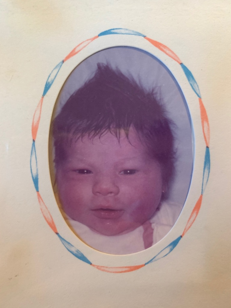 James as a newborn with a full head of hair.